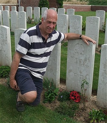Mick Roberts at his great uncle's gravestone